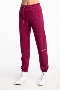 מכנסיים ארוכים קלווין קליין לנשים Calvin Klein OFF PLACED MONOGRAM JOGGING - סגול/ורוד